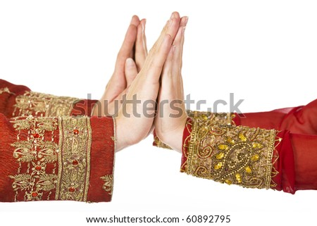 two hands in indian dress man and woman - stock photo