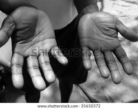 Two hands of a black man islander - stock photo
