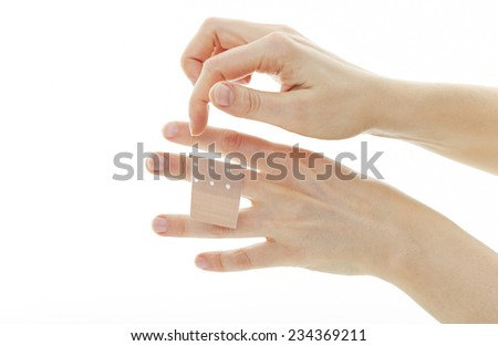 Two hands of a woman with a plaster