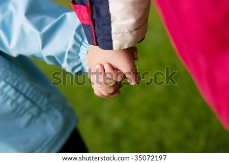 Two hands of baby on walk