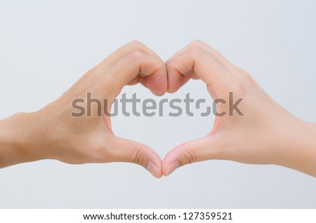 two hands of man and women together become one heart shape form in white background - stock photo