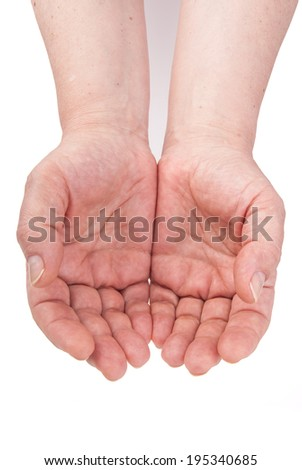 Two hands of mature woman in a gesture of care, offering or showing something isolated on white - stock photo
