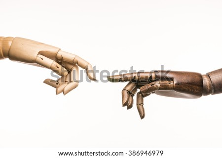 Two hands of wood parody the creation of Adam by Michelangelo. On white background. - stock photo