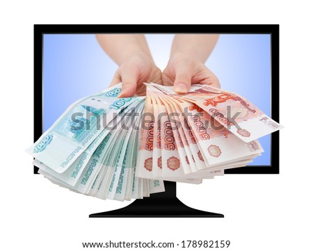 two hands offer two batches of many 1000 and 5000 rouble bills (the biggest Russian bond) out of computer screen - stock photo
