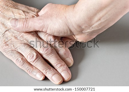 Two hands older and younger womans
