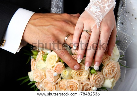 Two hands on a wedding dress - stock photo