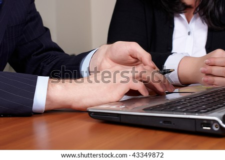 two hands on keyboard of laptop