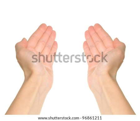Two hands reaching and holding a concept isolated on white background. First person point of view. - stock photo