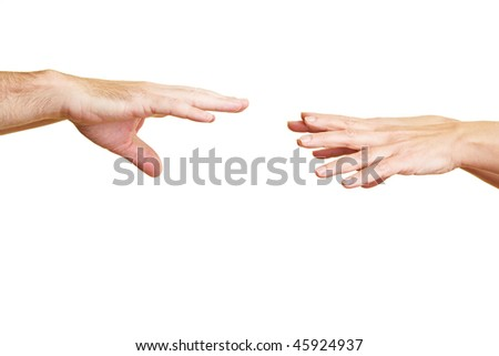 Two hands reaching for two other hands - stock photo