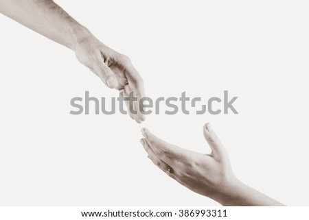 Two hands reaching toward each other. Helping concept. Vintage tone - stock photo