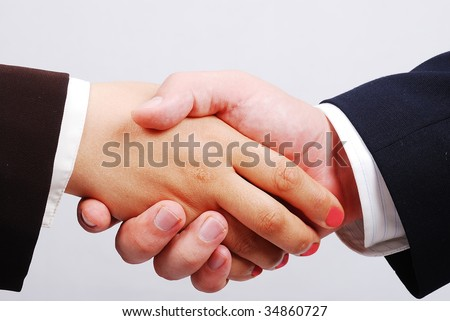 Two hands shaking, female and male - stock photo