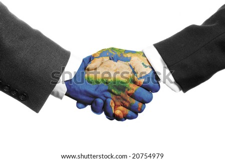 two hands shaking on a white background with a world map - stock photo