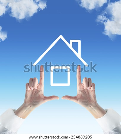 two hands showing house on sky background - stock photo