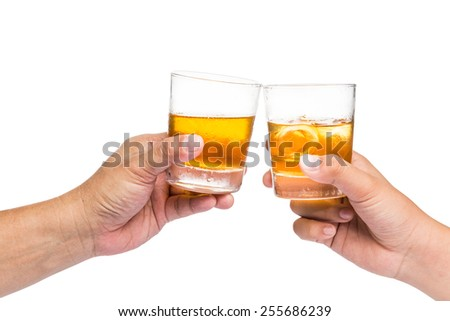 Two hands toasting whiskey on the rock, with isolated background - stock photo