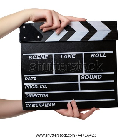 Two hands with a movie clapper board close. Isolated over white background - stock photo