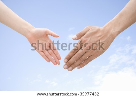 Two hands with beautiful blue sky