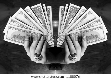 Two hands with dollars fan - stock photo