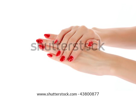 Two hands with the red manicure, isolated
