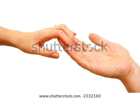 Two hands - woman and man touch each other in delicate, subtle way - stock photo