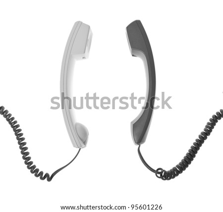 two handsets are talking - stock photo