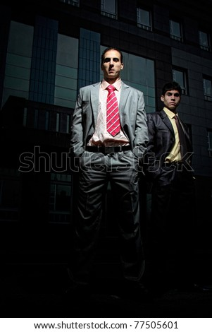 two Handsome  Businessman standing in front of corporate - stock photo