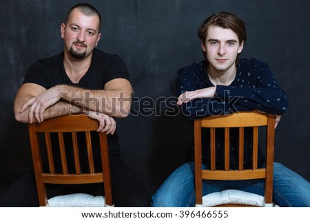 Two handsome mature studentslooking to camera - stock photo