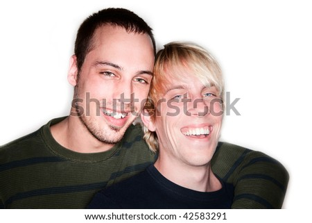 Two handsome men posing for portrait on white background - stock photo
