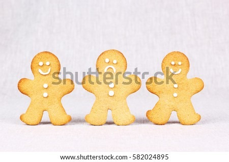 Two happy and one unhappy Gingerbread Men in a Row