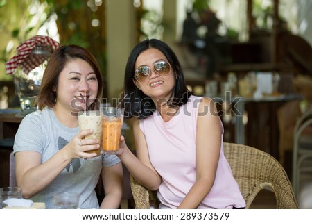 Two Happy asian Female in coffeeshop Cafe