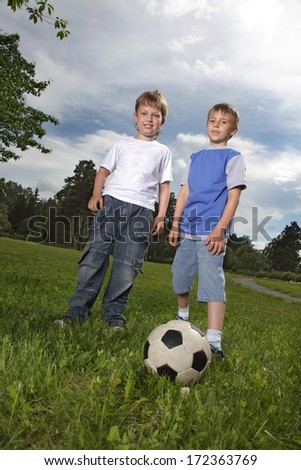 two happy boy play in football