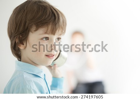 two happy boy play in the tin can phone - stock photo