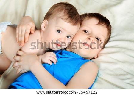 Two happy boys brothers at home. - stock photo