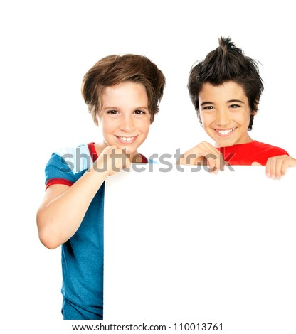 Two happy boys isolated on white background, cute male classmates hold white blank class board, group of teenager playing in classroom, best friends enjoying education at school, back to school - stock photo