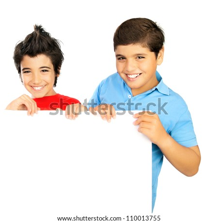 Two happy boys isolated on white background, pretty school student hold white blank board for ad, teenager playing in classroom, best friends enjoying education at school, back to school