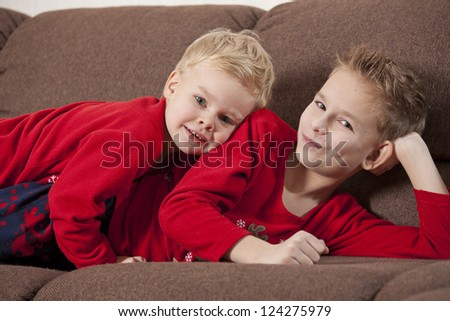 Two happy boys on the sofa - stock photo