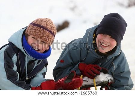 Two happy boys winter play - stock photo