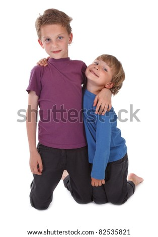 two happy brothers against white background - stock photo