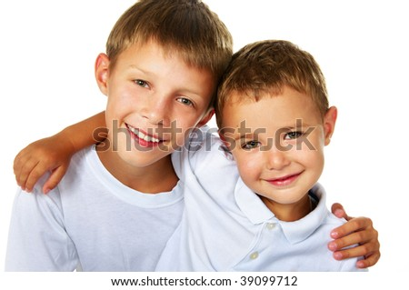 two happy brothers; closeup faces - stock photo