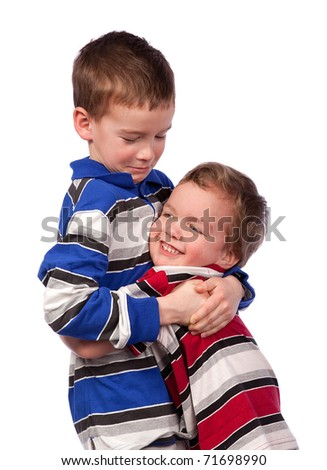Two happy brothers hugging - stock photo