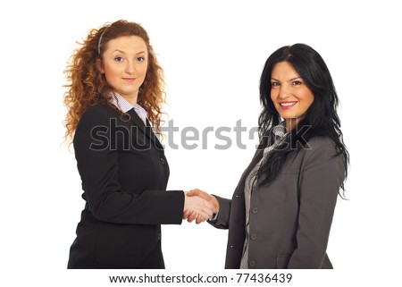Two happy business women giving handshake isolated on white background - stock photo