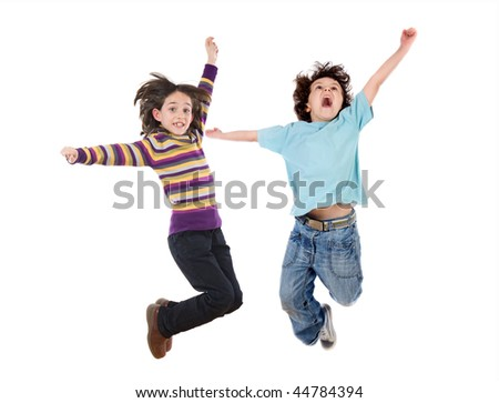 Two happy children jumping at once on a white background - stock photo