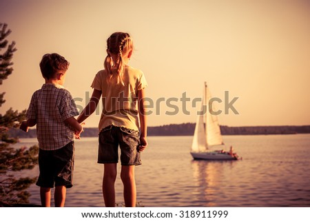 Two happy children  playing in the park at the day time. Concept Brother And Sister Together Forever - stock photo