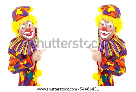 Two happy clowns pointing to a blank, white space.  Isolated.