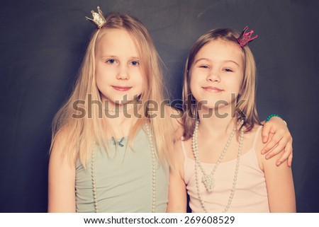 Two Happy Cute Girls Embracing - stock photo