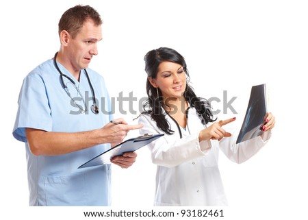 Two happy doctors having medical consultation of x-ray image