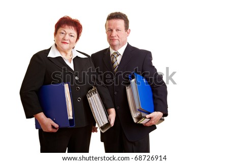 Two happy elderly business people carrying files