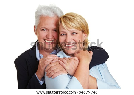 Two happy elderly women embracing each other - stock photo