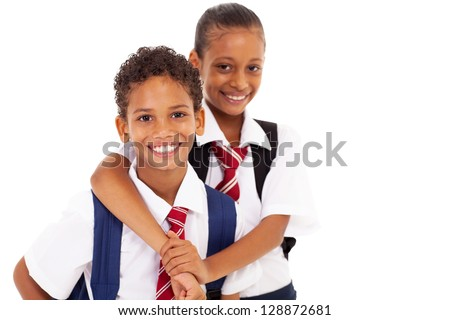 two happy elementary school friends on white - stock photo