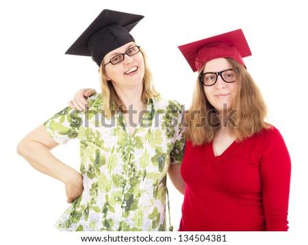 Two happy female graduates - stock photo