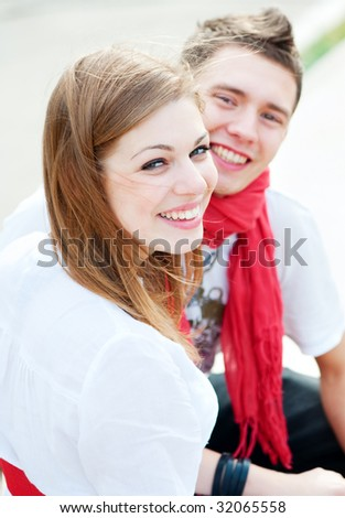 two happy friends at outdoor - stock photo